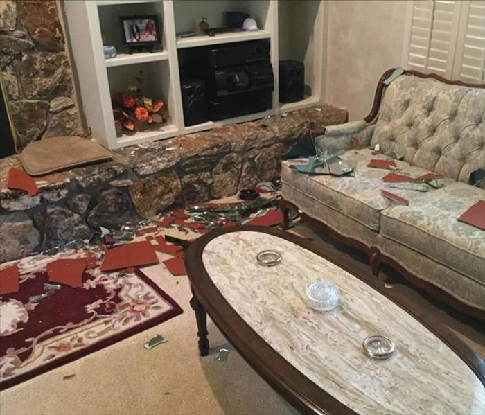 Broken Glass Throughout Living Room of Chico Home Before