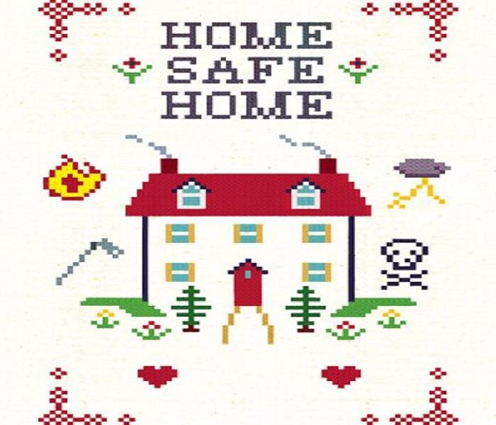Cross stitched house with home safe home written above.