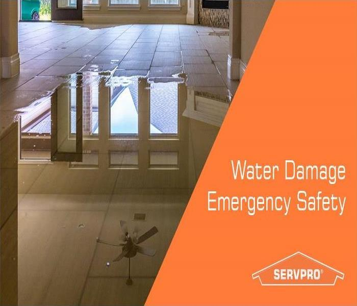 Water puddle on tile floor, with ceiling fan reflected. Text on right side of image stating Water Damage Emergency Safety.