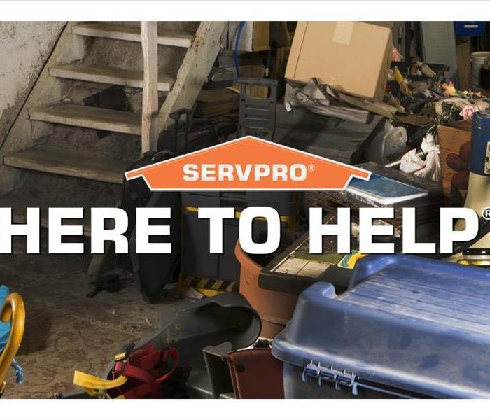 Items in basement with HERE TO HELP text and SERVPRO logo