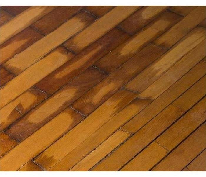 Hardwood floors with water damage